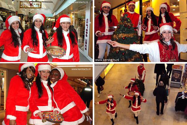 Kerst catering, winterentertainment Govers Evenementen, Kerstacts.nl, Culinair entertainment, Mobiele Swingende Kerstmeisjes in winkelcentrum met rollende kerstboom !!!
