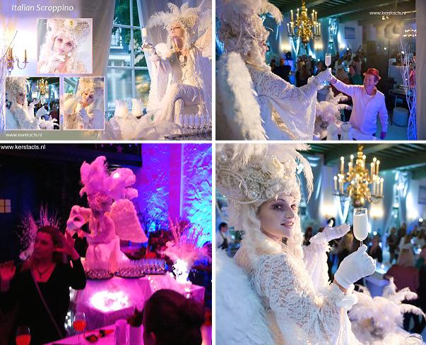 Witte kerstacts Winteracts, Deze White Angel schenkt - zittend op een tafel- de genodigden een glas champagne of prosecco in,