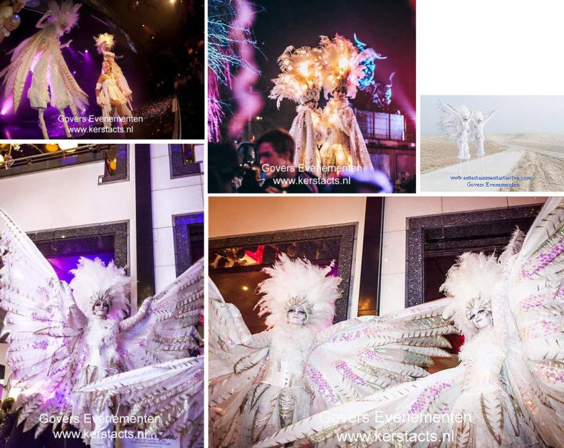 Winterentertainment, kerstacts.nl, kerst entertainment, steltenlopers, winterse stelten, kerstmuziek, steltentheater, kerst, sfeer, kerst op stelten, artiesten boeken, winters wit, artiestenbureau, kerst entertainment, duif, duif op stelten, witte winteracts, Govers Evenementen