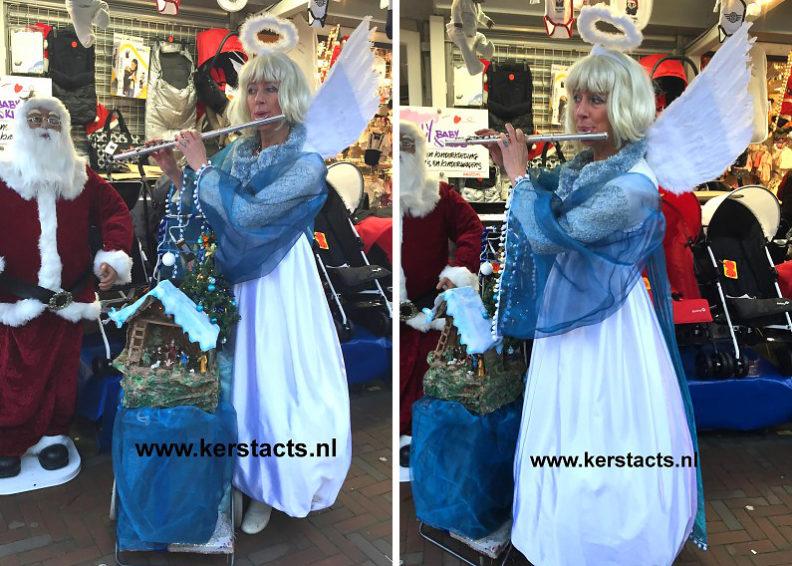 Witte Kerstengel = dwarsfluitiste, Verkleed als Witte Kerstengel weet de muzikante de juiste sfeer op uw kerstmarkt of winterbraderie te bewerkstelligen met haar gezellige kerstdeuntjes.