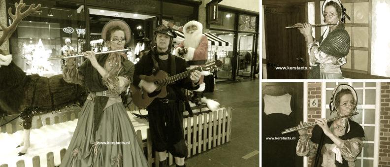 kerstmuzikant, kerstmuziek, kerstmuzikanten, Dickens muziek, charles dickens, Deze Dickensfluitist en gitarist spelen mooie kerstliedjes en melodietjes. Het rustgevende karakter van haar akoestisch vertolkte dwarsfluitmuziek maakt haar optredens uitermate geschikt is als achtergrondmuziek tijdens kerstmarkten, www.kerstacts.nl
