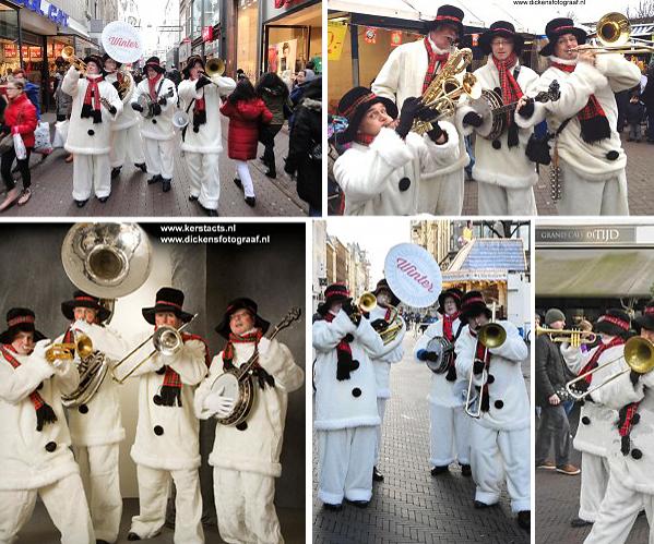 Sneeuwpoppen looporkest. Deze muzikanten vormen al jaren een hecht kwartet. Zij weten heel goed heel goed raad met de belangen van hun opdrachtgevers, en dus hebben zij ook Sneeuwpoppen kostuums laten vervaardigen, www.kerstacts.nl