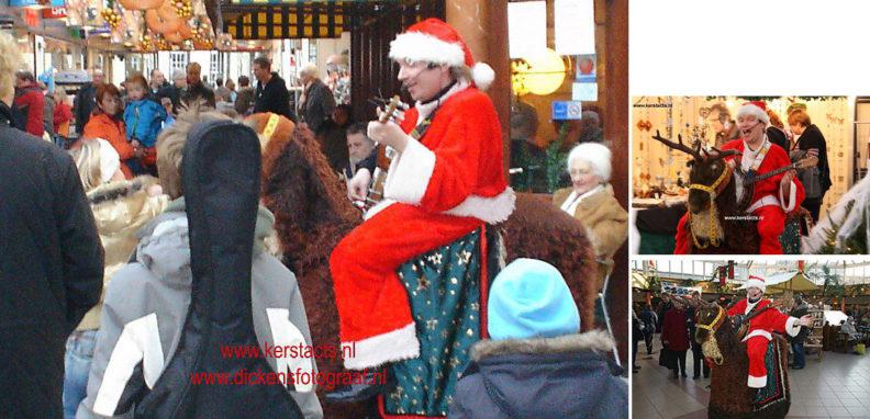 kerstmuziek, kerstmuzikanten, bandje, kerstentertainment, kerstartiesten boeken, muzikanten boeken, kerstkoor, themafeest, winterentertainment, wintermuziek, muziektrio, muziekduo, kerstzanger, kerstact, kerst repertoire, kersttijd, akoestiche muziek, mobiele muziek, winterfeest, nieuwjaarsfeest, stijlvolle muziek, muzikaal entertainment, kerstmis, kerstdiner, kerstborrel, kerstviering, kerstmarkt, kerstman muziek, white Christmas, Govers Evenementen, Kerstmuziek , de kerstman op rendier speelt gezellig kerstrepertoire tijdens de kerstmarkt, www.kerstacts.nl